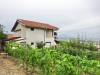 Масивна двуетажна къща с панорамен парцел до град Сандански
